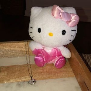Hello Kitty necklace and small Hello Kitty doll